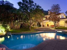Sharon Stone recently sold this secluded Mediterranean-style retreat in Beverly Hills. Almost every room in the house flows out to the beautiful grounds with a pool, an adjacent spa and large patios. Past the pool, winding paths lead to waterfalls, a fruit tree grove and a secluded meditation garden.