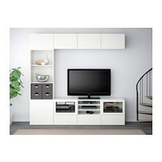 IKEA - BESTÅ, TV storage combination/glass doors, white Grundsviken/dark gray clear glass, drawer runner, soft-closing, , The drawers and doors close silently and softly, thanks to the integrated soft-closing function.You can control your electronic equipment with the doors closed, as the remote control works through the glass.The space-saving wall shelves make the most of the wall area above your TV.It's easy to keep the cords from your TV and other devices out of sight but close a...