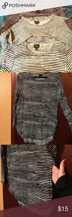 3 Mossimo striped shirts XL black grey white Note: this listing is for ALL 3 TOPS. Underarm measurement is 21.5in. These are by Mossimo and are striped tops with rounded hem and side split (intentional design😁). They are soft and have only been worn a handful of times. They are meant to fit a bit loose I think. Happy buying! Selling because I got other striped shirts I fell head over heels in love with. One is black with white stripes, one is white with black stripes and the other is white…