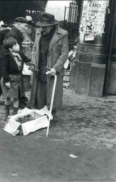 The violets seller and the little boy Paris circa 1950 Robert Frank