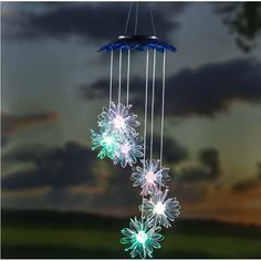 The Solar Garden Mobile Wind Chime adds a little light and a lot of fun on your porch or yard. A solar panel embedded in the top turns the dangling flower icons into a delightful color-changing display at night. Outdoor Hanging Lights, Outdoor Decor, Outdoor Living, Obelisk Trellis, Garden Trellis, Solar Path Lights, Flower Mobile, Garden Statues, Hearth
