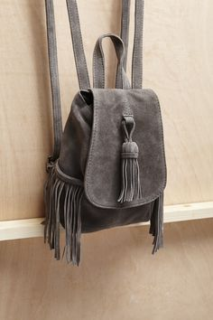 The #suede backpack of your dreams is here. With tassels galore, its perfect for #festival wearing next season, too – thinking long-term.