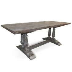 Capistrano Rectangular Dining Table. Materials: Alder hardwood Finish: White and grey multi-layer patina Decorative turned legs 2-inch thick solid wood table top Dimensions: 84 inches long x 40 inches deep x 30 inches tall