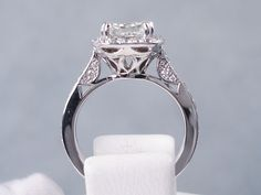 This is our amazing 2.55 ctw Cushion Cut Diamond Engagement Ring. It has a beauteous 2.02 carat Cushion Cut I Color/VS2 Clarity (Clarity Enhanced) Center Diamond that looks huge and sparkly. Accent diamonds line a halo and travel halfway down the band. This ring is listed for $9,990. See more pictures on our website, it is a beautiful high-quality clarity diamond! Cushion Cut Diamonds, Clarity, Halo, Cushions, Engagement Rings, Website, Amazing, Pictures, Travel