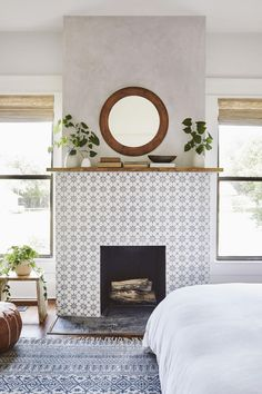 """The Ramsey House - Fixer Upper - """"I couldn't believe it when we found this fireplace all boarded up! We brought it back to life by covering it with hand-painted tile and a simple mantel, really making this room feel like a cozy master suite. Bedroom Fireplace, Farmhouse Fireplace, Home Fireplace, Fireplace Remodel, Brick Fireplace, Fireplace Design, Tile Bedroom, Master Bedroom, Stone Fireplaces"""