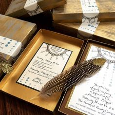 Lovely invitations by Katie Gaines of Love Paper Paint that were created using Modern Masters Metallic Paint. The box lids and feather tips were painted using a mixture of Brass and Champagne!