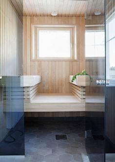 Seinäjoen asuntomessutalojen saunoissa ja kylpyhuoneissa näkyy harmaita laattoja ja sävytettyjä lauteita. Katso Avotakan valinnat.