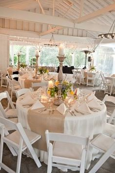 white table with burlap- I like the ratio of burlap to white table cloth and the candles