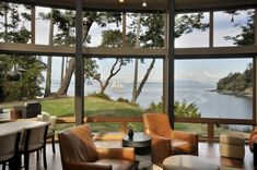 wood-house-with-curved-glass-walls-overlooking-sunset-bay-8.jpg