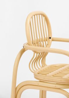 Made up of a circular frame, the backrest is connected to the chair's frame with a pivot joint. Meanwhile, a series of seven flexible cane rods curve round 90 degrees to join the backrest to the chair's seat. The seat slides in and out on a rail, so that as the user reclines their back, the seat slides outwards and vice versa.