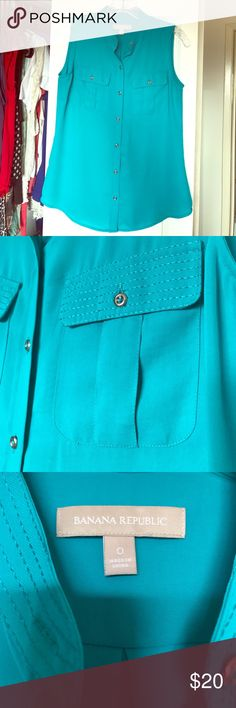 Banana Republic Button-down Sleeveless Blouse 100% Polyester. Teal. Slim but not tight fitting. Worn once. Banana Republic Tops Blouses