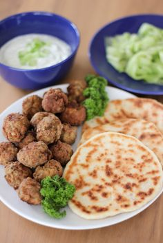 Greek food yum! keftedes and hommade pita and tzatziki