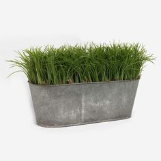 """This oval tin with grass makes a great backdrop for spring and summer decor or as a base to add your favorite decorative pieces. Faux grass is 4"""" tall. Oval container is 14"""" long x 5"""" wide x 9"""" tall ("""