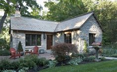 Houzz.com recently featured a unique cottage on the wooded side of beautiful Lake Minnetonka outside of Minneapolis. This incredible gatehouse features a vast collection of reclaimed wood and stone from the 1800s, as well as antique furniture.
