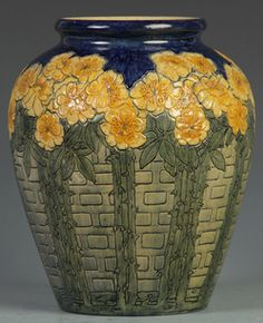 Newcomb College carved pottery vase, carved roses on a trellis background. Initialed HJ by artist Harriet Coulter Joor