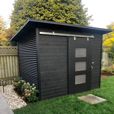 This 8x8 Essential-style garden shed is bound to impress those with minimal backyard space. Store miscellaneous items or that ugly pool hardware you've been meaning to hide. Black corrugated steel, black beauty stain on 1x6 pine t+g and of course, our custom sliding barn doors. Modern, bold and sleek. Contact us about your backyard shed today! Diy Storage Shed Plans, Backyard Storage Sheds, Backyard Sheds, Modern Backyard, Outdoor Sheds, Backyard Patio, Backyard Landscaping, Garden Office Shed, Pool Shed