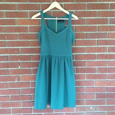 Emerald green party dress  Never been worn!  adorable, flattering, and super comfortable green dress. Sweetheart top, Razorback, exposed gold zipper, and hidden side pockets.. What more could a girl want!? Perfect with a pair of nude wedges or pumps. Cynthia Rowley Dresses
