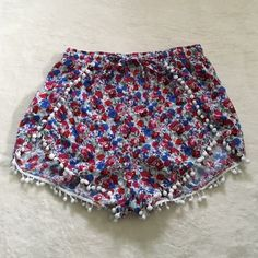 "• Floral Pom Pom Shorts • •Info Gently worn, these shorts are in excellent condition. Selling because it has gone untouched for quite some time!   •Measurements  Inseam: 1.5"" Waist: 11.5"" (but elastic stretch)  •Materials 100% Rayon  •Care Gentle hand wash cold, line dry in shade.  No Trades  24 hour holds ONLY No alternate transactions Make reasonable offers through offer button   Closet Instagram: @alexandra.como  Personal Instagram: @alexcomo Oxford Circus Shorts"