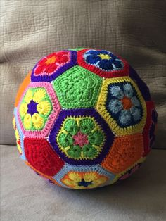 An African Flower Soccer Ball I made for a special 1-year-old birthday girl.  Pattern by: www.crochetbug.com/how-to-make-an-african-flower-soccer-ball/