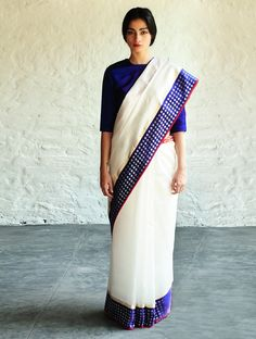 This exquisite cotton silk saree by Raw Mango is handwoven with mashroo, an…