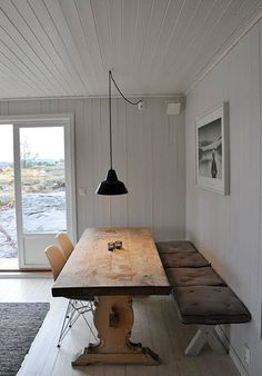 rustic trestle table with x-stools and eames eiffel chairs; interesting combo