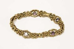 An Edwardian gold link bracelet, set with milligrain oval cut amethysts. £140 - £180 18/07/17