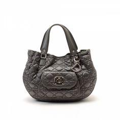 LXRandCo guarantees the authenticity of this vintage Dior Hand Bag handbag. d7d9867fa5