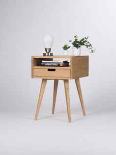 We designed our bedside table so it could grant many decorative functions and suit to any interior. We have created it inspired with the mid-century modern Scandinavian style - its simplicity and form. Our nightstand, made of solid oak wood and wood covered with natural oak veneer, has been perfectly finished with hardwax oil. Wood protected that way breathes while preserving all its most desired characteristics. We offer different versions of drawer fronts: solid oak, black mat, white mat…