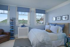 This white-trimmed master bedroom achieves a bright and beach-style look with wide use of light blue and light tone palette.