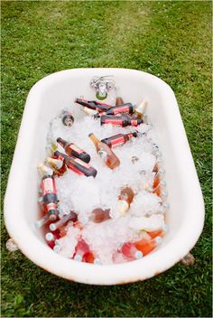 bath tub full of drinks - would like this now. (;