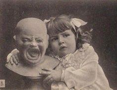 Creepy vintage postcard girl with ugly crying doll  --- Bah hahahahaha!! Love this description.