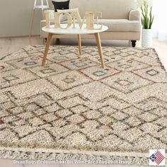 Tikki off Whites freehand diamond pattern creates a casual feel with pops of earth tone colors. This stylish and simple shag pleasing to the touch and offers an element of visual interest to any room...