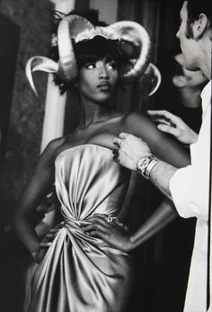 Naomi Campbell for Alexander McQueen for Givenchy, 1997. Behind the scenes Naomi Campbell and Hairstylist Nicolas Jurnjack getting ready for the show.