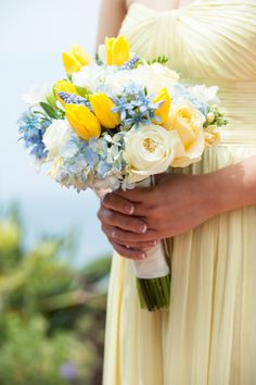 Yellow and light blue bouquet. Tulips, hydrangea, roses, tweedia, muscari blue, stock. Florals by Jenny
