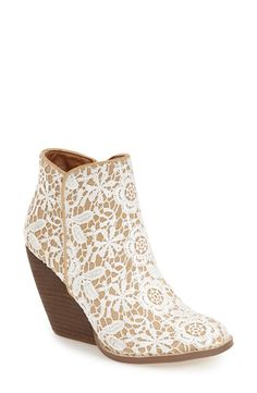 A gorgeous lace overlay adorns these comfy booties for a shabby-chic vibe.