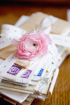 Vintage Love Letters - stacked with a single bloom in the centre of the table