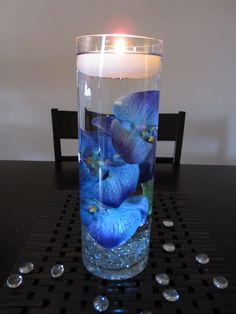 like the floating orchid. not so keen on the candle..