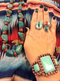 Sleeping Beauty raw turquoise and old trade beads necklace by Brian Snyder at Bohemian Metals. Turquoise and coral cuff by Dean Brown at eBay. Turquoise and opal middle ring from eBay. Turquoise and red coral ring from eBay.