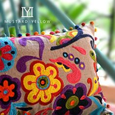 Colorful souzani cushion cover with pompom