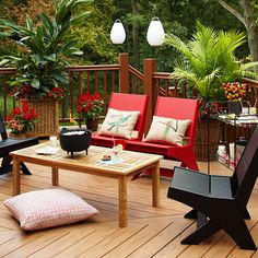 Coordinate the colors of flowers and patio furniture for a bold, trendy deck. More patios: http://www.bhg.com/home-improvement/patio/24-patio-perk-ups/?socsrc=bhgpin031613reddeck