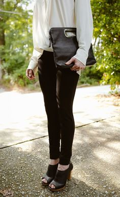 The bag is just so-so, but what I like about this is the drapey shirt with the skinny jeans and booties. Good combo!