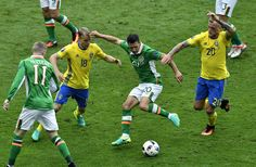 Ireland's midfielder Wesley Hoolahan (2nd R) shoots to score a goal during the Euro 2016 group E football match between Ireland and Sweden at the Stade de France stadium in Saint-Denis on June 13, 2016. / AFP / PHILIPPE LOPEZ
