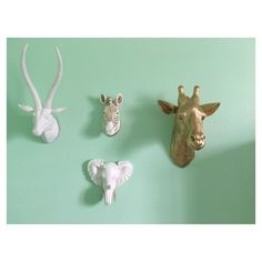 Loving how she mixed white and gold animals for this safari gallery wall!