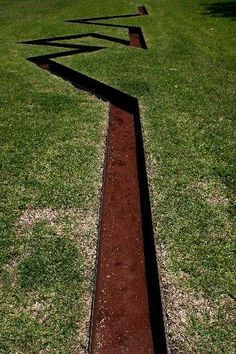 Drains - (Circumflex, Dissipate, Rift) - through the grass outside The Menil Collection, Museum in Houston, Texas.