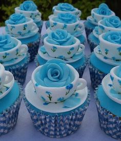 Fancy blue rose and teacup cupcakes
