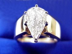 Pear Cut Diamond Ring: 2.03 carat with 1.61 ratio in six-prong Cathedral style mounting