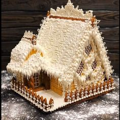 Exquisite gingerbread house masterly decorated with white frosting. Pastry chef d' oevres collection. Cool Gingerbread Houses, Gingerbread House Parties, Gingerbread Decorations, Christmas Gingerbread House, Christmas Sweets, Christmas Goodies, Christmas Candy, Christmas Baking, Gingerbread Cookies