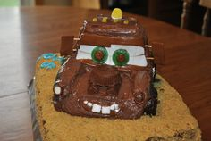 Mater Birthday Cake!  This was a GIANT pain.  But seeing my 2 year old's face light up was worth it!  I used two 13x9 cakes.  3/4 of one was the base, and then cut and molded the other to make the cab of the truck.  Crumb coat the cake and cool.  Use hoho's for the front hood sides, chocolate donuts for the wheels, kit kats for tow rigging and for the engine block.  Reeses' PB cup for the air cleaner.  Roll warm tootsie rolls and cut for windows.  Gum for windshield & lifesaver eyes!