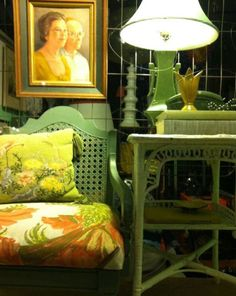 Painted wicker. Printed linen. Tulip vase. Asian lamp. Vintage books. Needlepoint pillow.