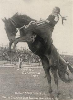 World champion female bronc rider Fannie Sperry Steele (1887-1983) at the 1913 Winnipeg Stampede.